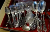 2 sterling flatware sets