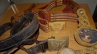 Civil War belt buckles and Spanish American War items belonging to Brigadier General H. S. Tanner